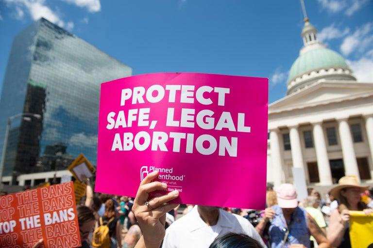 "Planned Parenthood will not comply with the Trump administration's ban on referring patients for abortion, the organisation said Tuesday.Instead, the family planning clinics will stop accepting federal money, tapping into emergency funding as they pressure lawmakers to reverse the administration's ban.On Monday, the Department of Health and Human Services notified the family planning clinics, including Planned Parenthood, that it would begin enforcing a new regulation banning abortion referrals. Another law, which will take effect next year, will require clinics maintain separate finances from facilities that provide abortions. The rule is being challenged in federal court, but the administration maintains that there's no legal obstacle to enforcing it. ""We are not going to comply with a regulation that would require health care providers to not give full information to their patients,"" Jacqueline Ayers, the group's top lobbyist, said in an interview Tuesday. ""We believe as a health care provider it is wrong to withhold health care information from patients.""Ms Ayers also said that she's not sure how long that backup funding will last. Experts suggest that low-income families will be hit hardest by the move. The federal family planning program serves about four million women annually through independent clinics, and taxpayers provide about $260m a year in grants to clinics. By law, that money cannot be used to pay for abortions. The Trump administration's rule moves an already strict relationship between clinics and abortion services further to the right, rewarding the conservative base that sees an anti-abortion agenda as a top priority. While vigilant and increasingly powerful, that base remains in the minority, as polls show most that Americans do not want the Supreme Court to overturn Roe v Wade, and the uproar as abortion access across the US is targeted becomes stronger.Planned Parenthood itself is undergoing changes, seemingly to fight harder against the religious right's dominance over the current administration. On Monday, the organisation announced the departure of its president, physician Leana Wen, who cited ""philosophical differences"" in a letter to the staff. Sources suggest that Dr Wen was not up to the political challenges the group faces. Political organiser Alexis McGill Johnson was named as acting president in her leave."