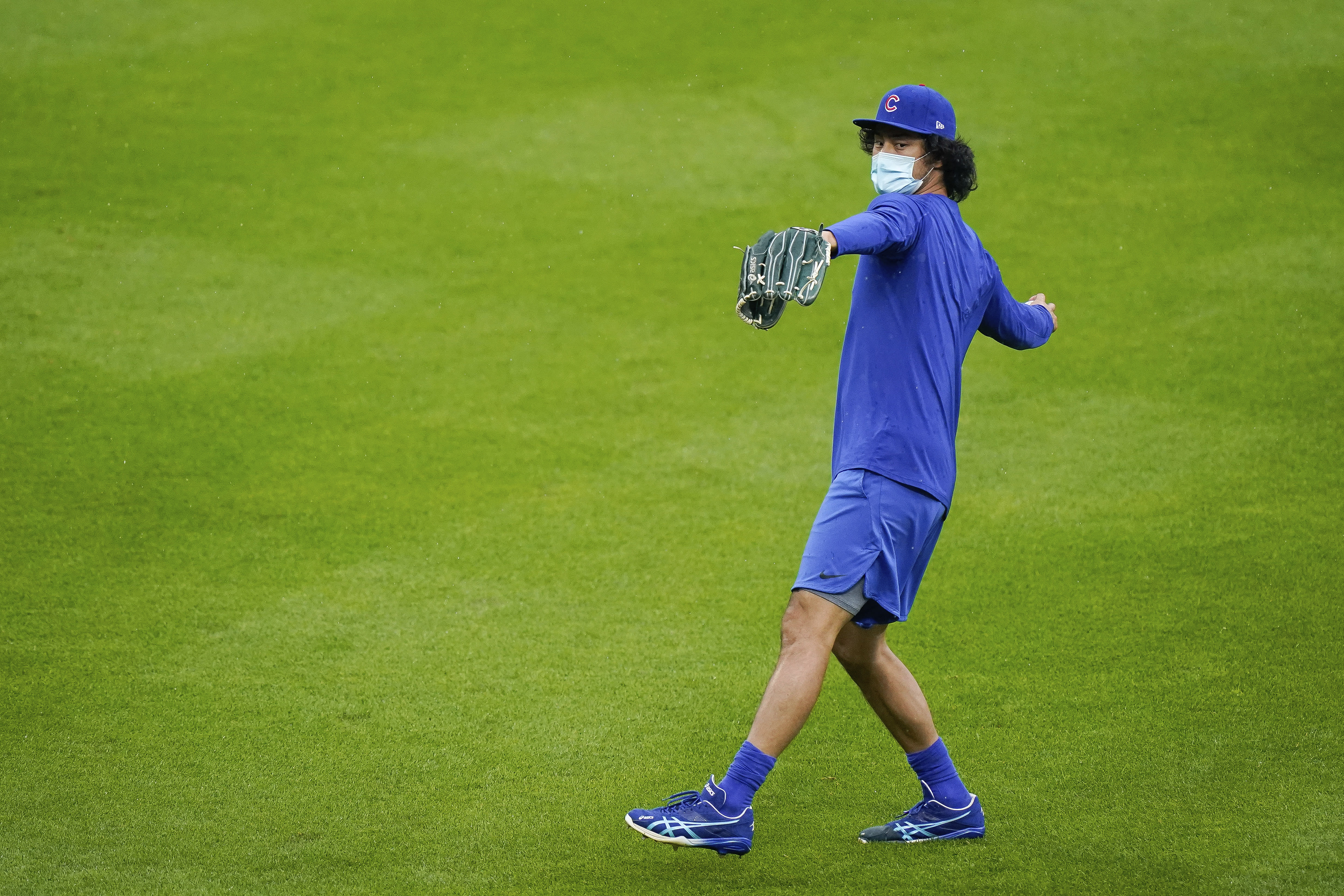 Chicago Cubs starting pitcher Yu Darvish (11), Thursday's scheduled starter, warms up prior to a baseball game against the Cincinnati Reds at Great American Ballpark in Cincinnati, Thursday, July 30, 2020. (AP Photo/Bryan Woolston)