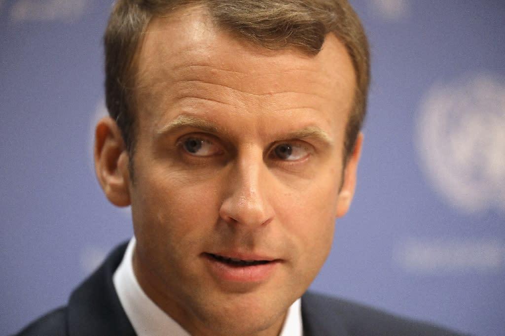 President Emmanuel Macron has low approval ratings (AFP Photo/JOHN MOORE)