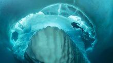 Atemberaubende Fotos zeigen Tauchgang unter riesigem Eisberg