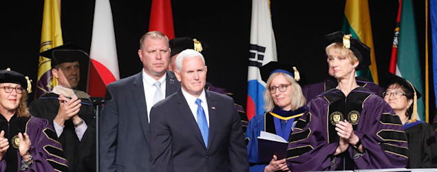 Dozens walk out before Mike Pence's commencement address at Taylor University. (USA Today)