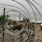 US Army unfurls miles of fencing along border with Mexico
