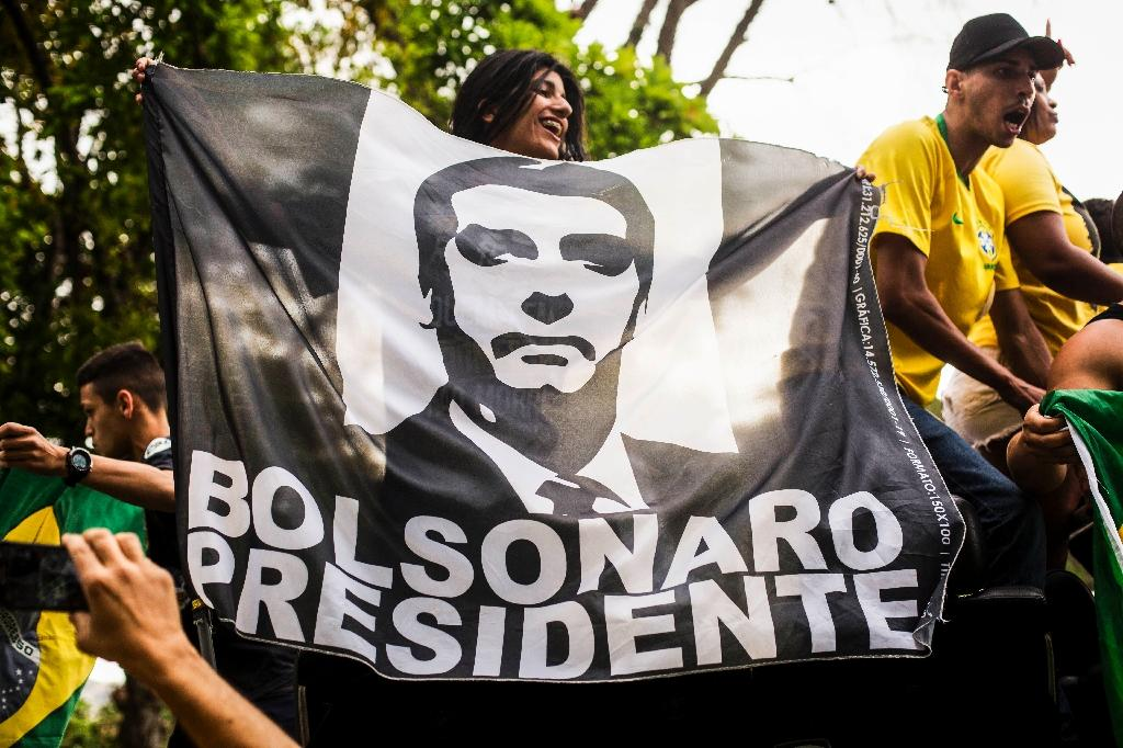 Bolsonaro has fervent fans -- and a 75-percent popularity rating (AFP Photo/DANIEL RAMALHO)