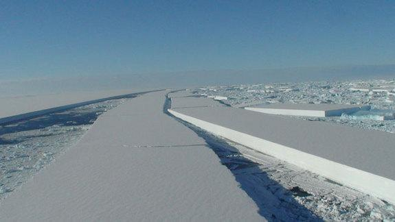 An image of the Wilkins Ice Shelf disintegration taken from the British Antarctic Survey's Twin Otter aircraft reconnaissance flight.