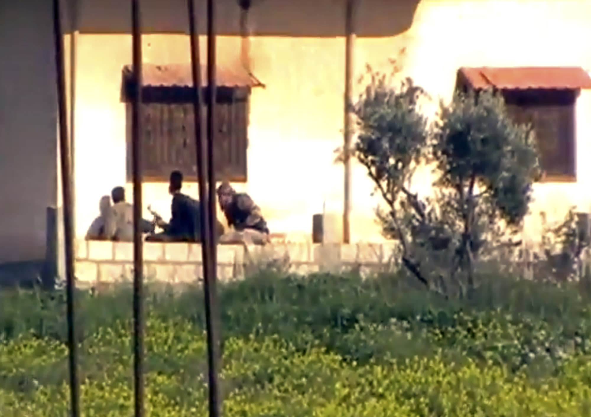 In this Thursday March 28, 2013 image taken from video obtained from the Shaam News Network, which has been authenticated based on its contents and other AP reporting, shows heavy clashes between Syrian Free Army fighters and the regime's army in Dael less than 15 kilometers (10 miles) from the Jordanian border in Daraa province, Syria. Syrian rebels on Friday captured a strategic town near the border with Jordan after a day of fierce clashes that killed dozens of people, activists said, as opposition fighters expand their presence in the south, considered a gateway to Damascus. (AP Photo/Shaam News Network via AP video)
