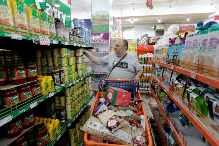 Lebanese shoppers have been stockpiling supplies amid fears that a currency crisis could produce food shortages (AFP Photo/ANWAR AMRO)