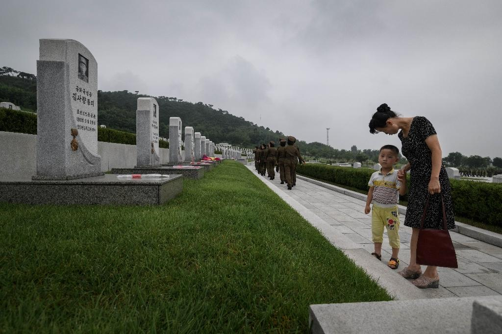 The rows of graves at the heroes' cemetery are arranged chronologically, by time of death (AFP Photo/Ed JONES)