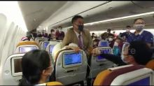 Thai Airways cabin crew wrestle Chinese passenger into her seat after she 'deliberately coughed at them'