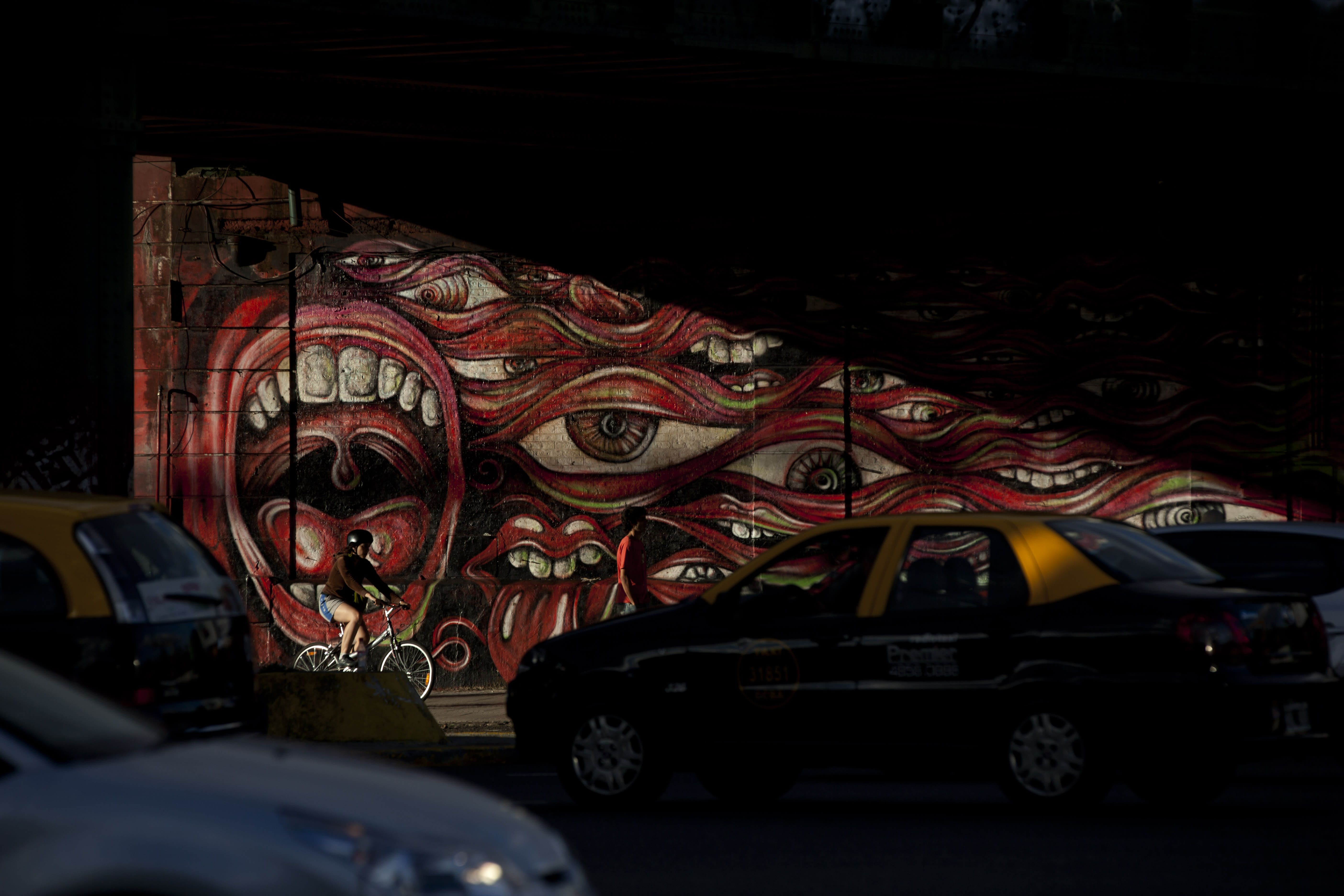 "In this March 5, 2013 photo, a mural titled ""Por Una Cabeza"" by artist Pelado covers a wall in the Palermo neighborhood of Buenos Aires Argentina. Buenos Aires has become one of the world's top capitals for international street art, with painters from around the world converting the walls of plazas and buildings into enormous murals in hopes of surprising passers-by. (AP Photo/Natacha Pisarenko)"
