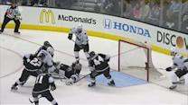 Pavelski cleans up loose puck past Quick