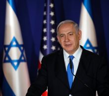 Netanyahu says to sue main election challengers for libel