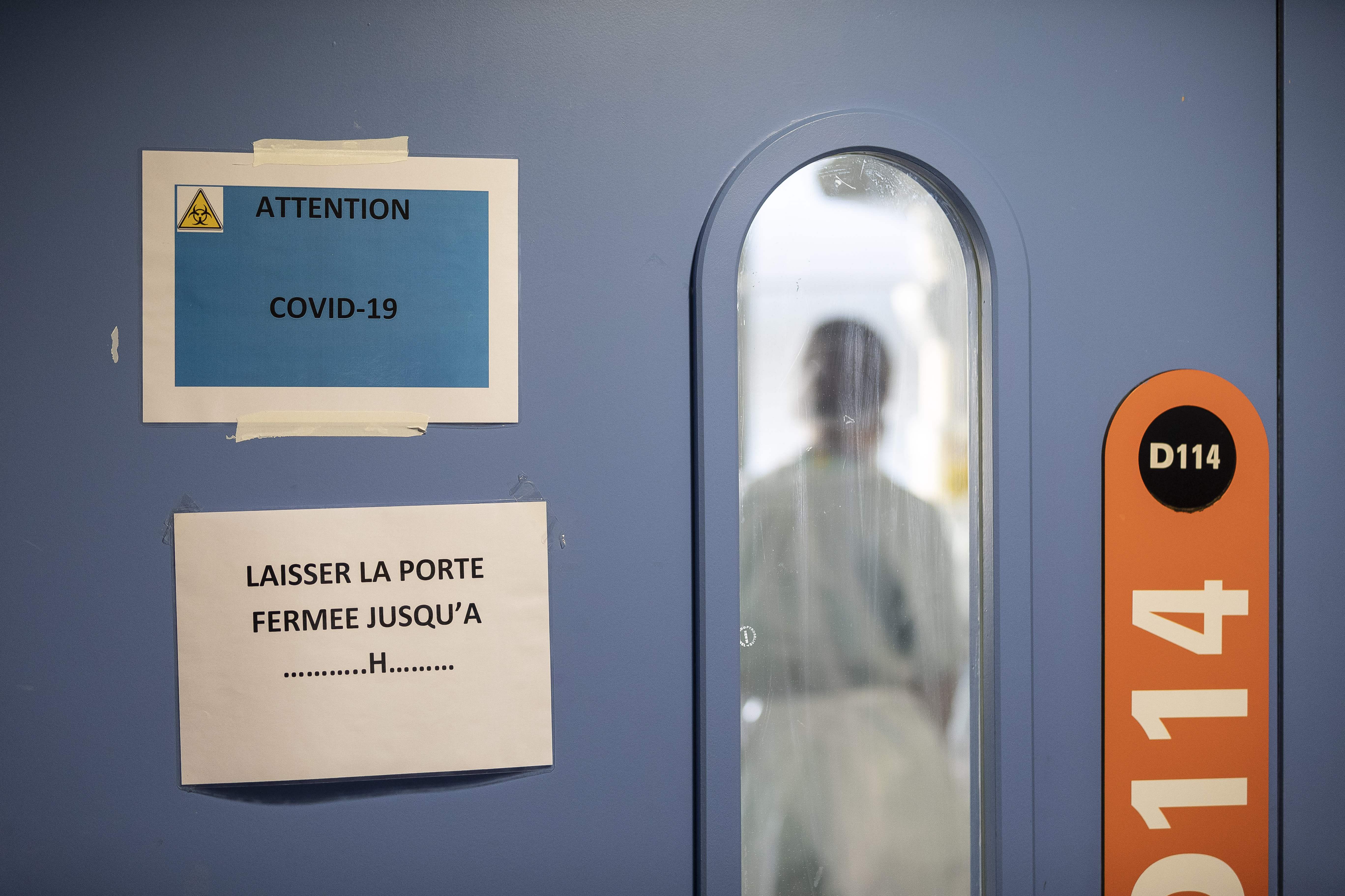 A nurse is seen in a COVID-19 area of the Nouvel Hospital Civil of Strasbourg, Eastern France, Tuesday, Sept.15, 2020. France is grappling with the double headache of trying revive its COVID-battered economy while also curbing the steady climb in infections spread during summer months when vacationers let their guard down and picked up by increased testing. (AP Photo/Jean-Francois Badias)