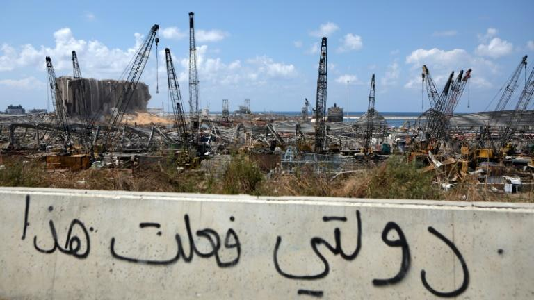 Graffiti reading 'my country did this' in Arabic was scrawled on a wall overlooking Beirut's port after the massive August 4 explosion that devastated the city