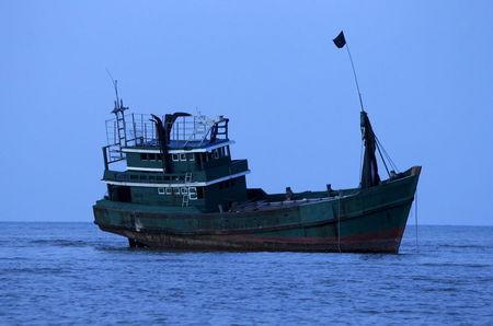 FILE PHOTO: An abandoned boat which carried Rohingya and Bangladeshi migrants from Thailand is found off the coast near the city of Kuta Binje