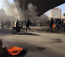 Four dead in Iran fuel protest after government hikes pump prices up to 300 per cent