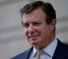 Donald Trump's former campaign chairman Paul Manafort appears in court in a wheelchair