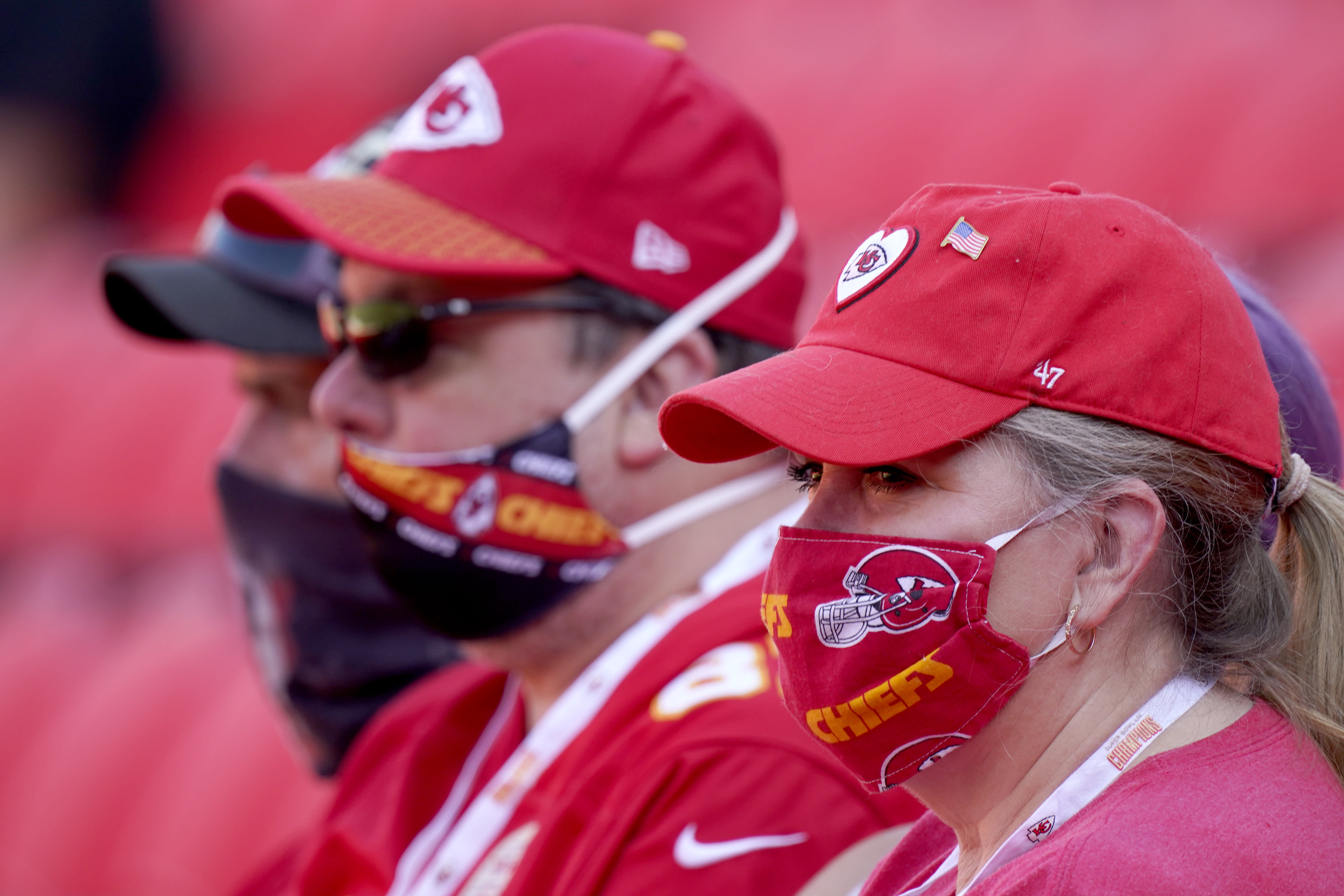 Fans wearing face masks watch the Kansas City Chiefs during an NFL football training camp Saturday, Aug. 22, 2020, at Arrowhead Stadium in Kansas City, Mo. The Chiefs opened the stadium to 2,000 season ticket holders to watch practice as the team plans to open the regular season with a reduced capacity of approximately 22 percent or normal. (AP Photo/Charlie Riedel)