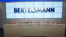 Bertelsmann books strong first half, ups Penguin stake