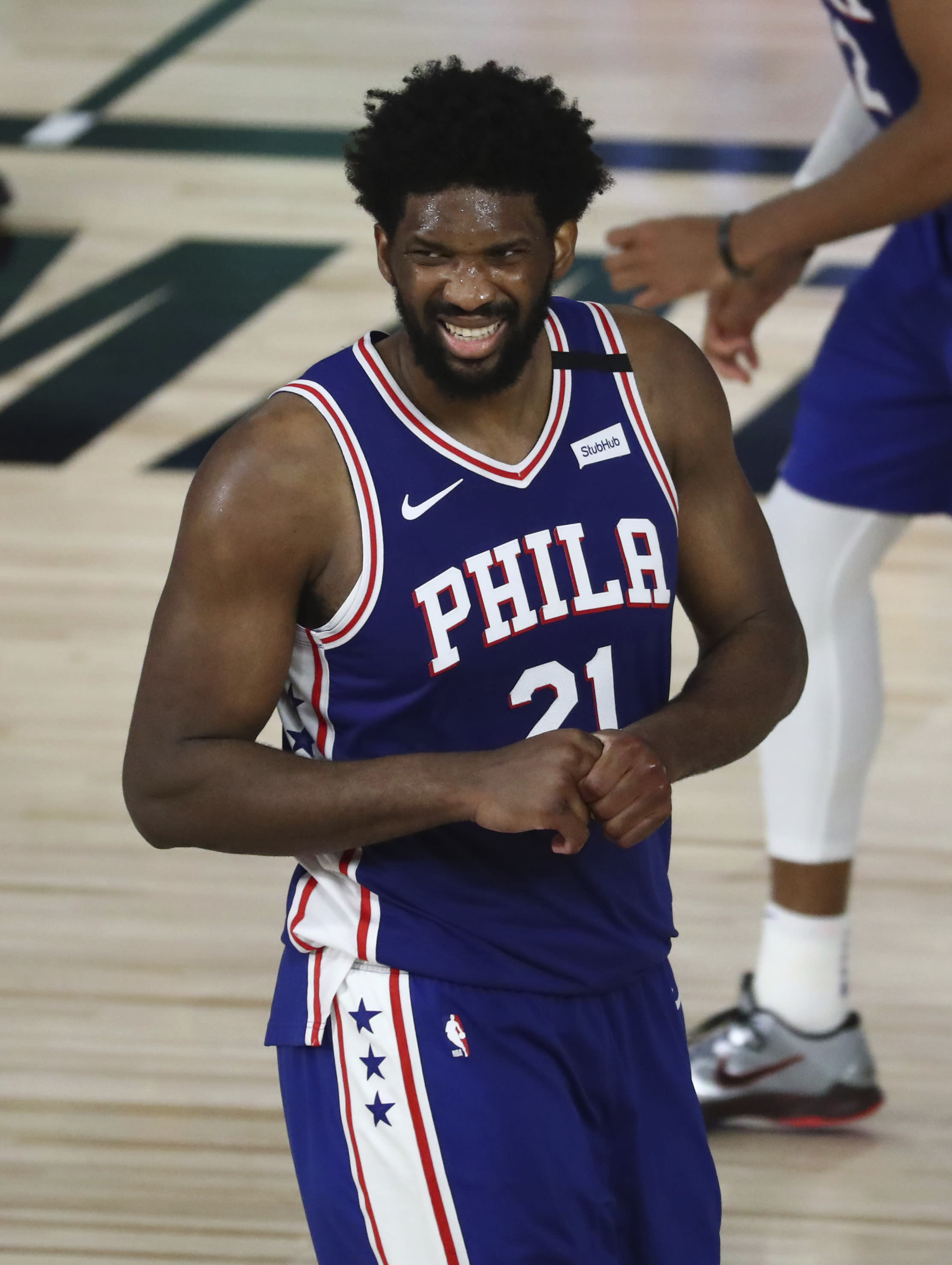 Philadelphia 76ers center Joel Embiid (21) reacts during the second half against the Boston Celtics in Game 3 of an NBA basketball first-round playoff series, Friday, Aug. 21, 2020, in Lake Buena Vista, Fla. (Kim Klement/Pool Photo via AP)