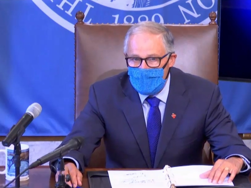 Gov. Jay Inslee wears a face covering while announcing new restrictions during a news conference in Olympia, Wash. on Thursday, July 23, 2020.