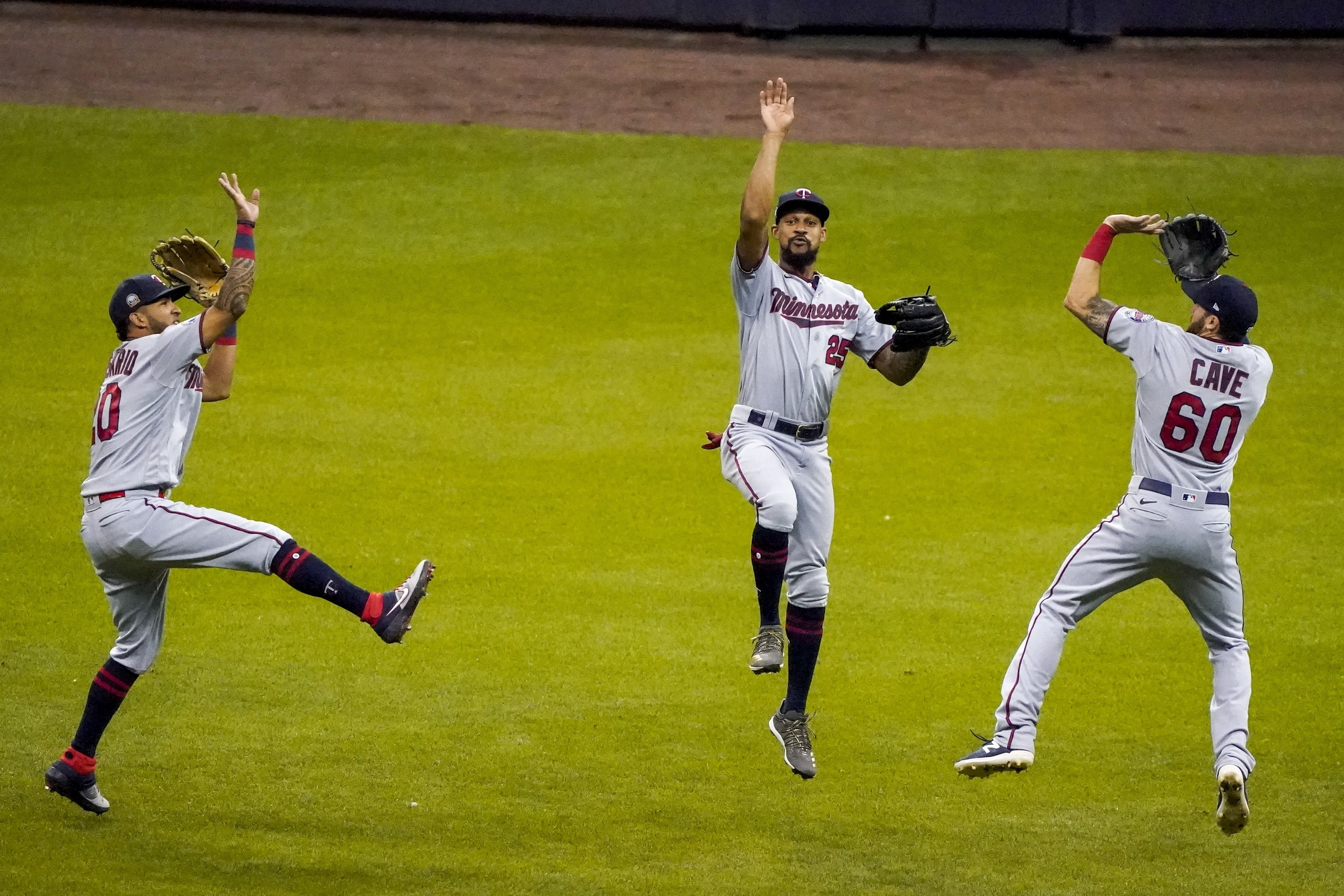 Minnesota Twins' Eddie Rosario, Byron Buxton and Jake Cave celebrate after a baseball game against the Milwaukee Brewers Wednesday, Aug. 12, 2020, in Milwaukee. The Twins won 12-2. (AP Photo/Morry Gash)
