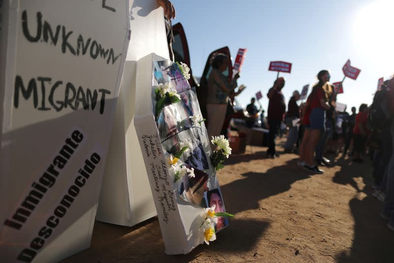 FILE PHOTO: People protest outside the ICE immigration detention center in Adelanto
