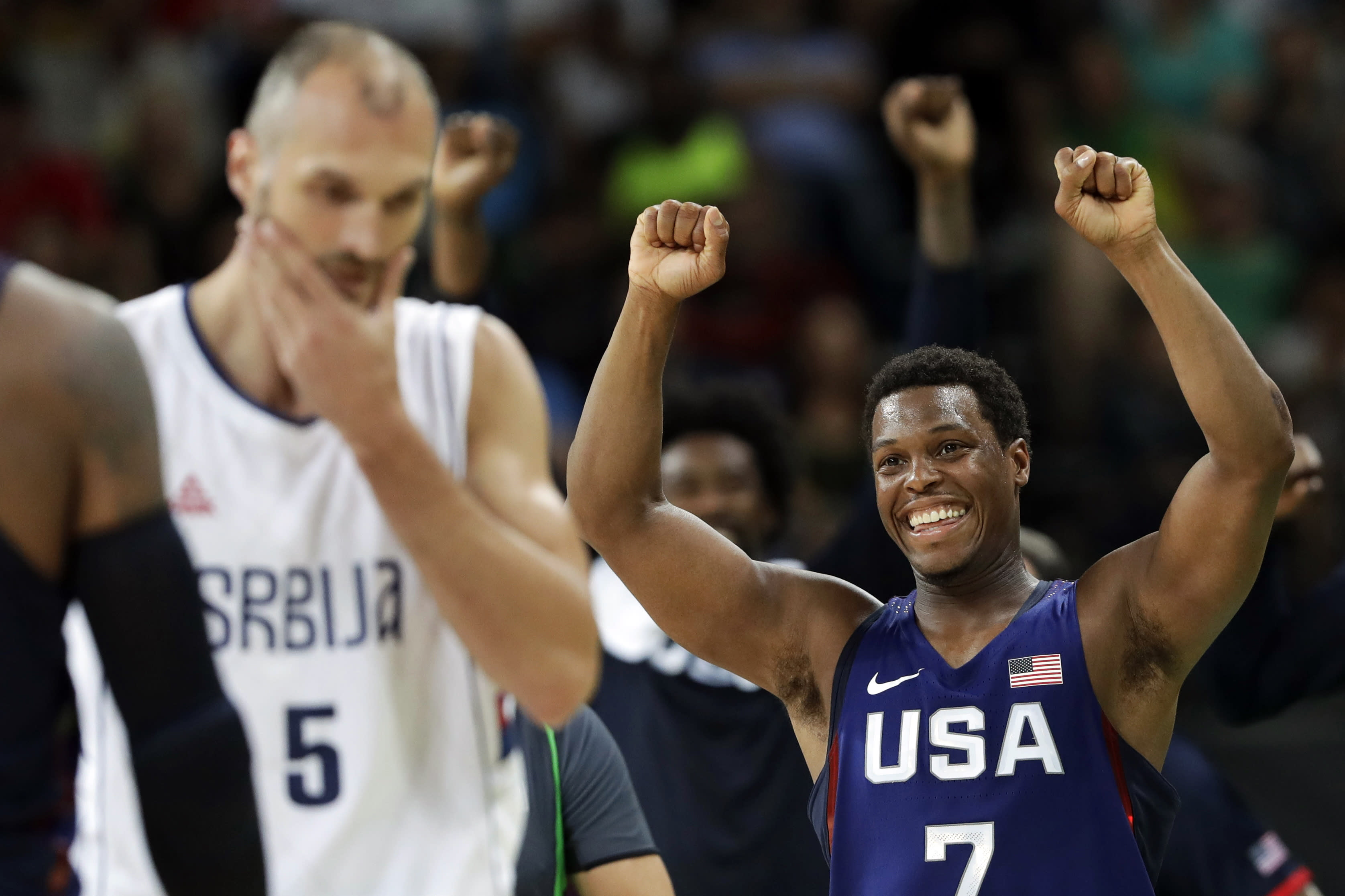 FILE - In this Aug. 21, 2016, file photo, United States' Kyle Lowry (7) celebrates near Serbia's Marko Simonovic (5) in the men's gold medal basketball game at the 2016 Summer Olympics in Rio de Janeiro, Brazil. Lowry has spent an extended stretch away from home during the summer. While unprecedented as part of an NBA season, it isn't exactly a foreign concept for those with USA Basketball experience like the Olympics and the World Cup.(AP Photo/Eric Gay, File)