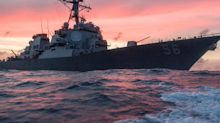 Russia claims a US warship ran away after one of its destroyers threatened to ram it, but the US Navy says it didn't happen