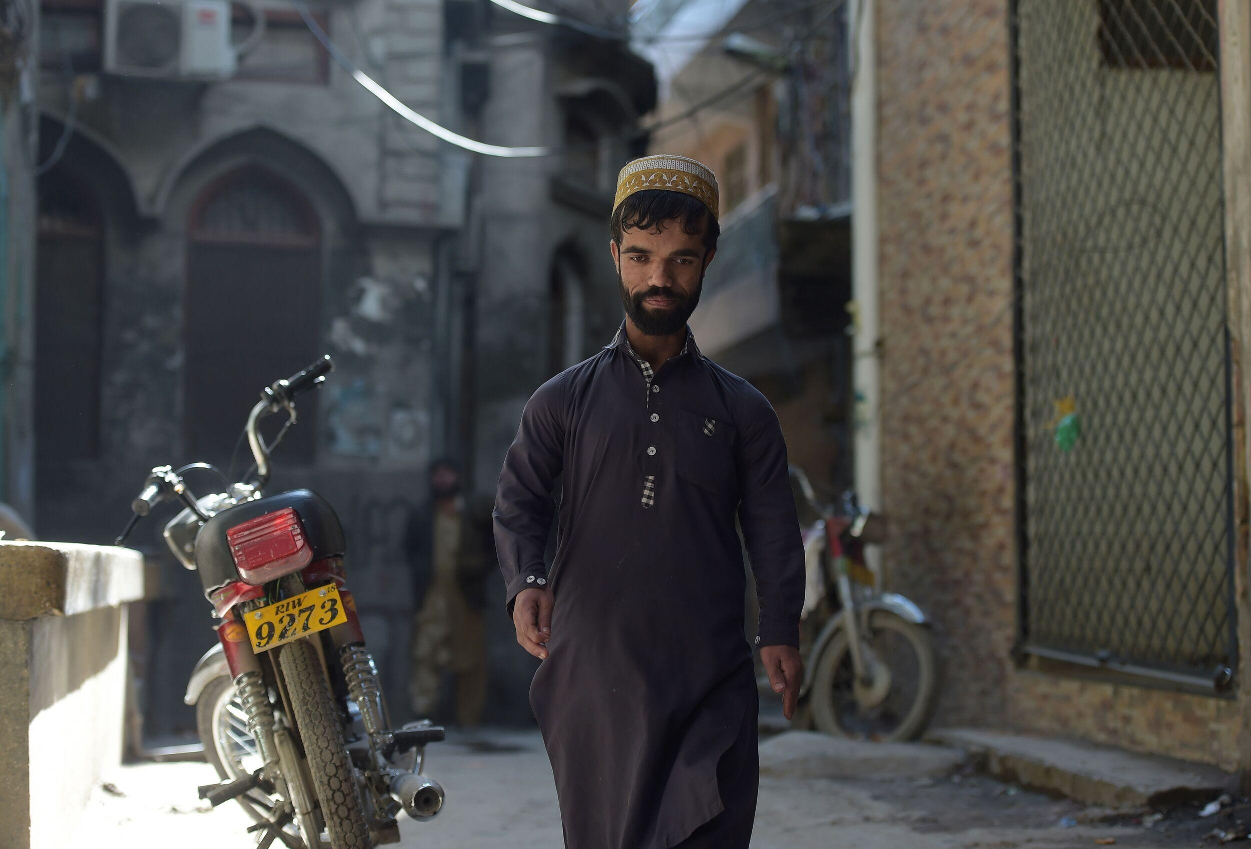 In this picture taken on February 22, 2019, Pakistani waiter Rozi Khan, 25, who resembles US actor Peter Dinklage, walks on a street in Rawalpindi. - Rozi Khan had never heard of the Game of Thrones -- or its hugely popular character Tyrion Lannister -- until his striking resemblance to the dwarf anti-hero got heads turning at home. (Photo by AAMIR QURESHI / AFP) / To go with PAKISTAN-LIFESTYLE-TELEVISION-ENTERTAINMENT        (Photo credit should read AAMIR QURESHI/AFP/Getty Images)
