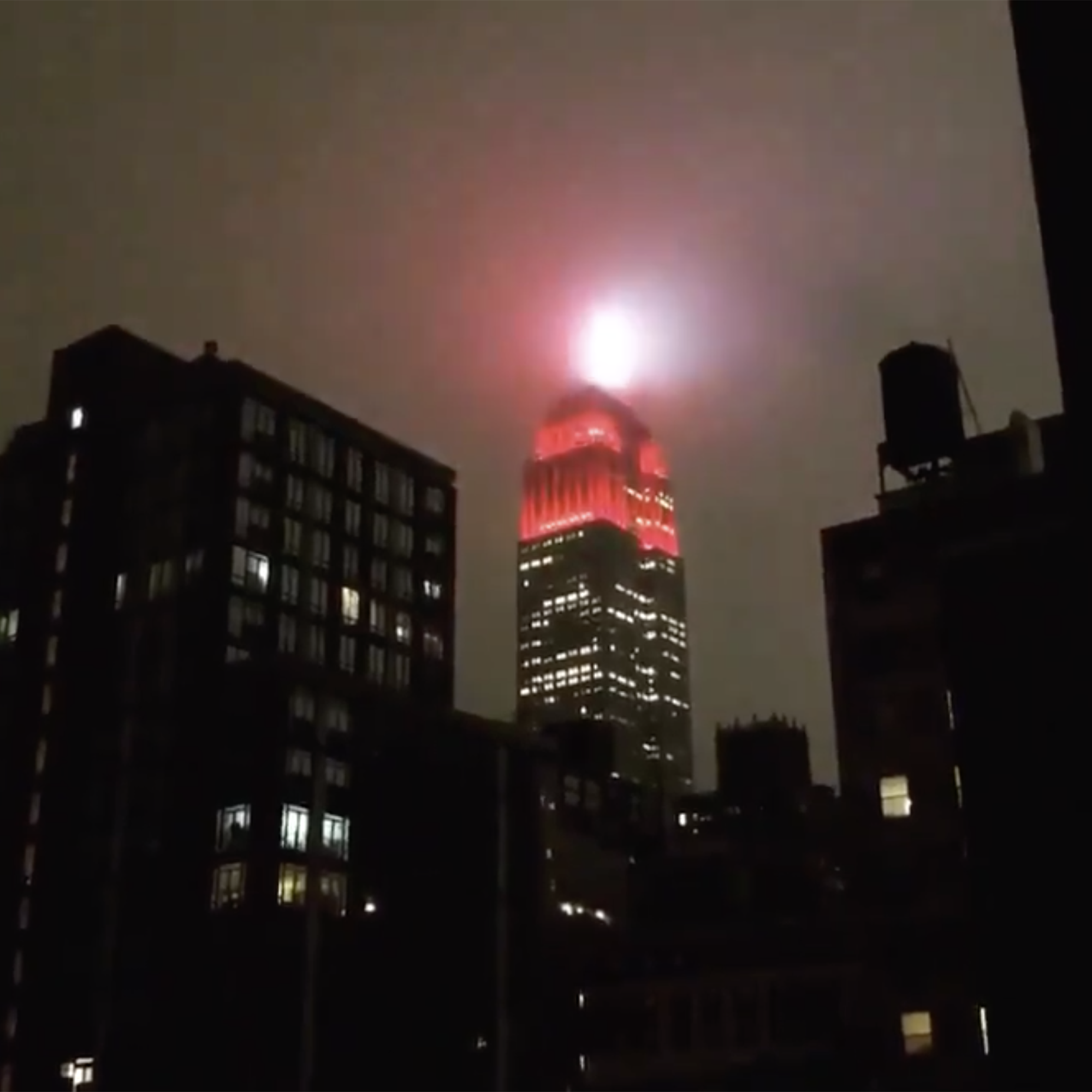 Empire State Building lights up with red and white siren