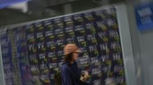 Asian markets mostly gain, dollar struggles after inflation data