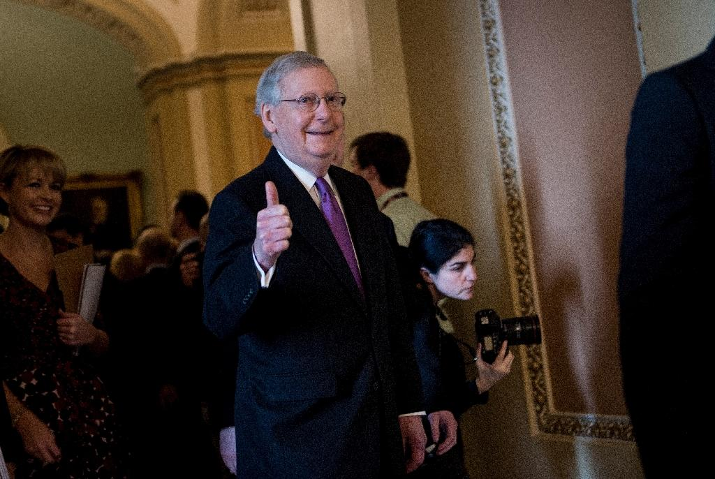 Top US Senate Democrat Chuck Schumer reached a deal with Republican Majority Leader Mitch McConnell, pictured, on ending the shutdown (AFP Photo/Brendan Smialowski)