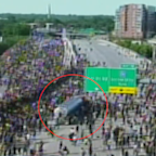 Truck driver arrested after appearing to drive into protesters