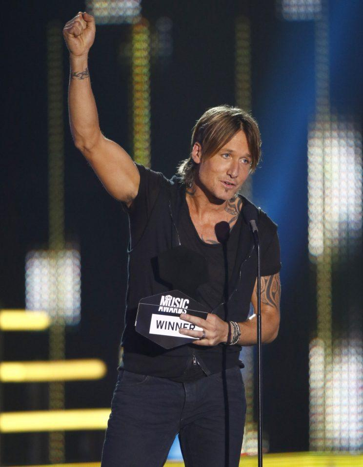 Keith Urban accepts one of his many awards at the CMT Music Awards. (Photo by Wade Payne/Invision/AP)