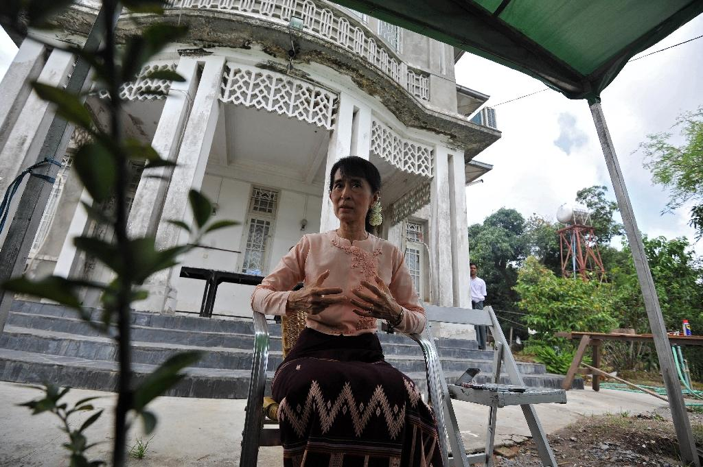 A petrol bomb was thrown at the lakeside Yangon compound of Myanmar's leader Aung San Suu Kyi Thursday while she was away from her home, a small, rare attack on the villa where she was held for long years of house arrest by the former junta (AFP Photo/Soe Than WIN)