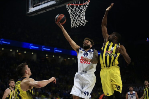 Fenerbahce's Ekpe Udoh, right, tries to stop Real Madrid's Jeffery Taylor during the Final Four Euroleague semifinal in May. (AP)