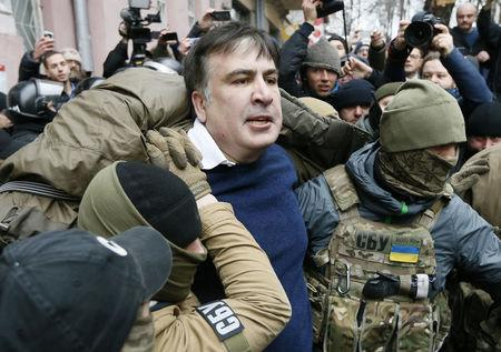Georgian former President Mikheil Saakashvili is detained by officers of the Security Service of Ukraine, conducting a search of his apartment, in Kiev