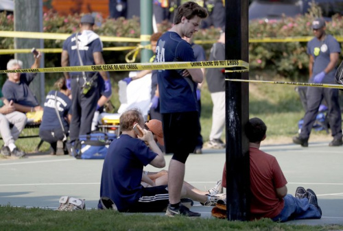 People stand near the scene of a shooting at the Republican Congressional baseball team practice in Alexandria, Va, June 14, 2017. (Shawn Thew/EPA)