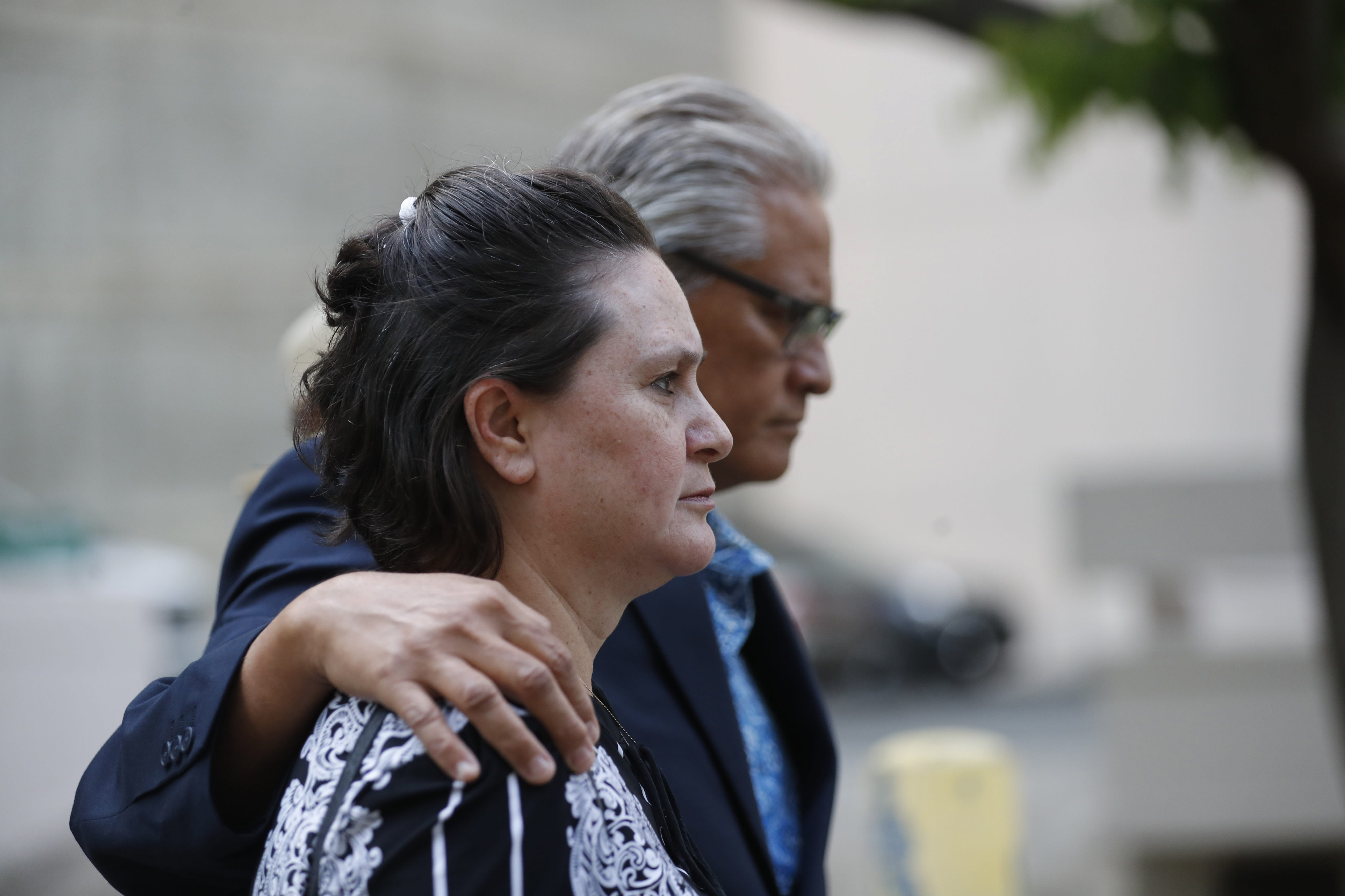 Former deputy prosecutor Katherine Kealoha, left, and husband, former Honolulu police chief Louis Kealoha, walk toward Queen Street after the verdict in their corruption case at federal court Thursday, June 27, 2019, in Honolulu. A jury has found the Kealohas guilty in a plot to frame a relative to silence him from revealing fraud that financed their lavish lifestyle, a case that shook the top levels of law enforcement. The jury found both Kealohas guilty of conspiracy. (Cindy Ellen Russell/Honolulu Star-Advertiser via AP)