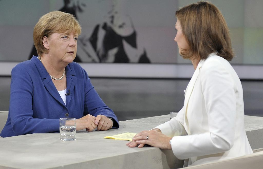 "This photo made available by public broadcaster ZDF shows German Chancellor Angela Merkel (L) during recording of the ""Summer Interview"" with ZDF's Bettina Schausten in their studio in Berlin on August 16, 2015 (AFP Photo/Jurgen Detmers)"