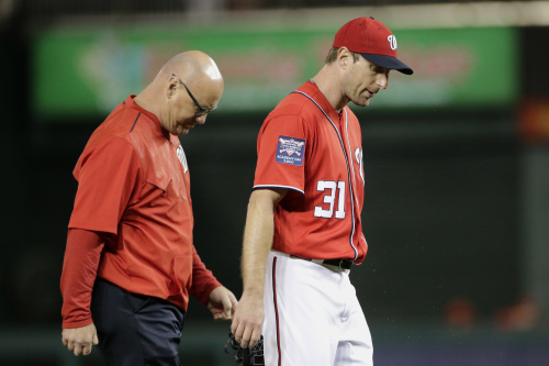 Washington Nationals starting pitcher Max Scherzer, right, left Saturday's game with a hamstring injury. (AP Photo/Mark Tenally)