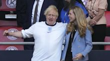 Boris Johnson dons England shirt to cheer on semi-final win against Denmark with wife Carrie