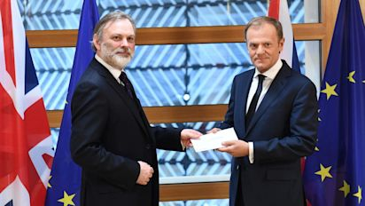 Sir Tim Barrow makes history as he delivers Theresa May's Article 50 letter into the hands of Donald Tusk, the European Council president