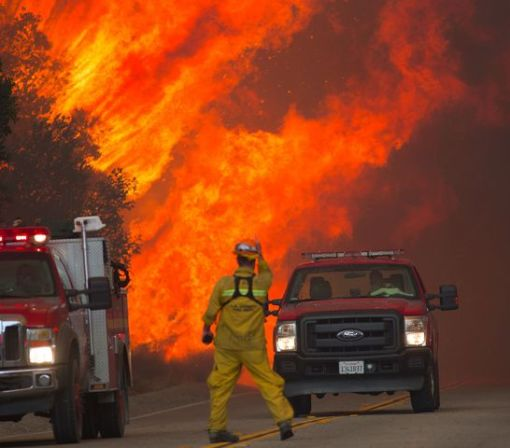 Massive wildfire near Los Angeles kills one person, forces thousands to flee