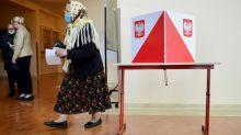 Polarised Poles vote in tight presidential race