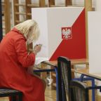 The Latest: Polish ruling party leader declares victory