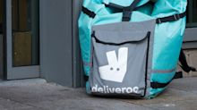 REFILE-UPDATE 4-UK competition regulator puts brake on Amazon's Deliveroo deal