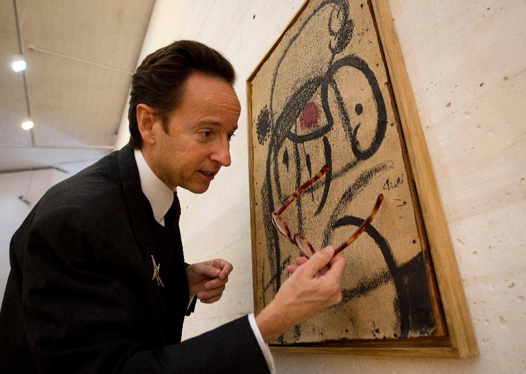 "Joan Punyet Miro, grandson of Spanish artist Joan Miro, looks at a painting during the exhibition ""Joan Miro - The Light of the Night"" at the Fundacio Pilar i Joan Miro in Palma de Mallorca on December 4, 2014"
