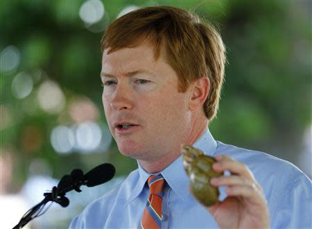 Florida Commissioner of Agriculture Adam Putnam holds a shell as he speaks at a news conference about successes in attempts to eradicate the Giant African Land Snail in Miami, Florida August 29, 2013. REUTERS/Joe Skipper