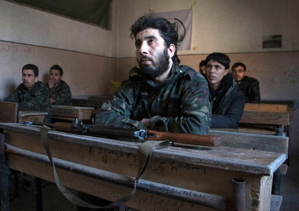 New recruits attend a briefing during training at a camp in a rebel-held area of the northern Syrian city of Aleppo (AFP Photo/Karam Al-Masri)